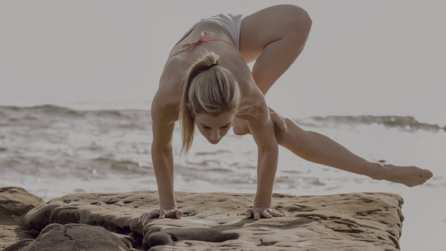 woman practicing yoga on the beach small overlay