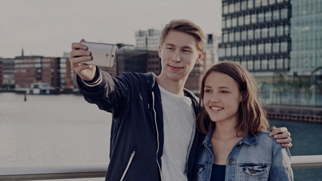 young couple taking a selfie small overlay