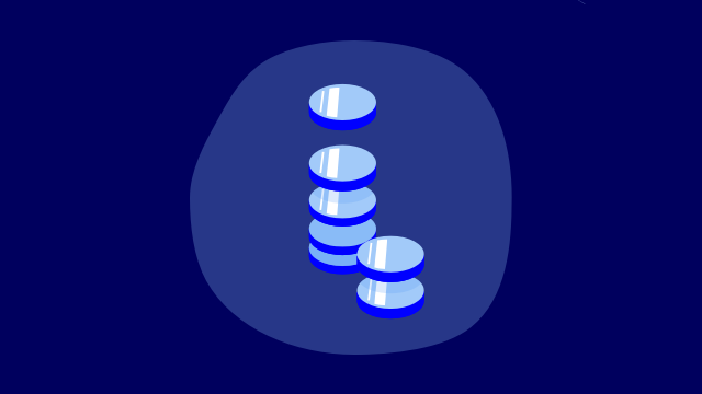 stack of coins on blue background
